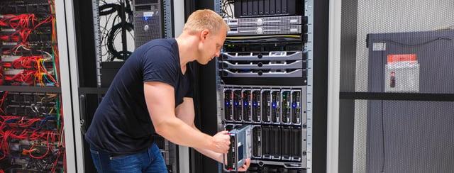 computer-engineer-installing-server-into-blade-PTRAN9S.jpg